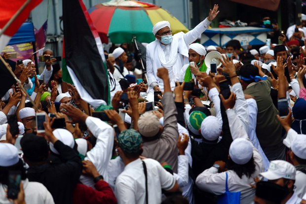 Muhammad Rizieq Shihab, the leader of Indonesian Islamic Defenders' Front, is greeted by supporters in Tanah Abang, Jakarta, Nov. 10, 2020.