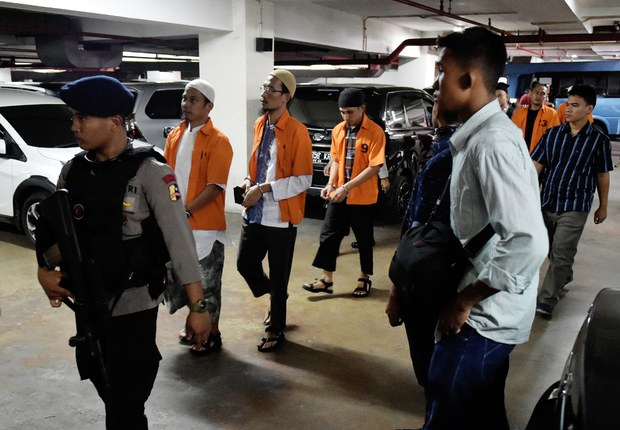 Indonesian police escort a group of suspected terrorists linked to Bahrun Naim before their June 15, 2016, trial in Jakarta on charges they planned to detonate a bomb in the Central Java city of Solo in August 2015.