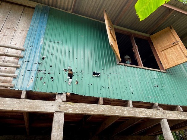 In this photo taken on May 7, 2021, bullet holes pock a house in Krong Pinang, a village in southern Thailand's Yala province, where two insurgents spent the last hours of their lives before being killed during a standoff with government forces three days earlier.