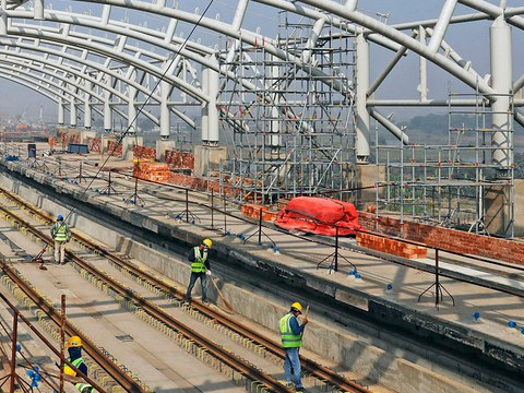 Construction crews work on the Dhaka Metro Rail project in Bangladesh, Jan. 28, 2021.