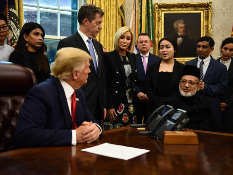 U.S. President Donald Trump meets with survivors of religious persecution, including Rohingya activist Muhib Ullah (second from right) at the White House in Washington, July 17, 2019.