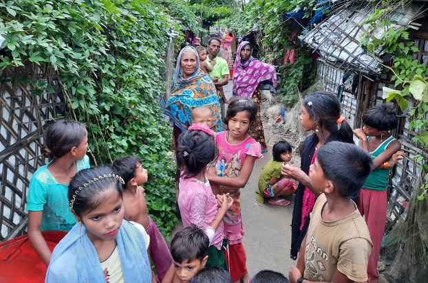 Rohingya women and children stand outside their homes in the Baharchara refugee camp in Teknaf in Cox's Bazar, Bangladesh, Aug. 16, 2020. [Sunil Barua/BenarNews]