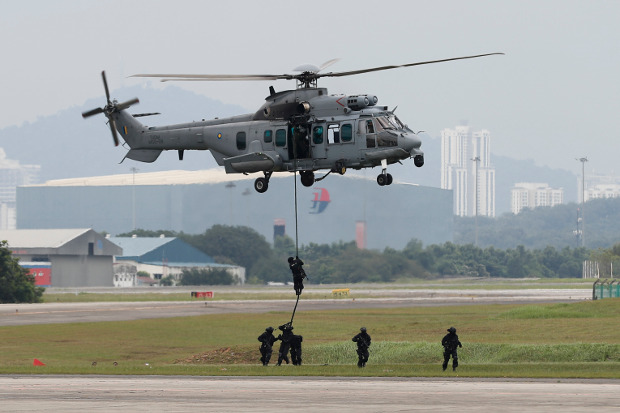 Special Forces demonstrate skills during a drill in combatting terrorism from a helicopter after the launching of joint patrols between Malaysia, Indonesia and Philippine at the Subang military airbase in Petaling Jaya, Malaysia, Oct. 12, 2017.
