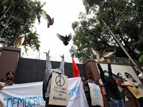 People release pigeons as they protest the military coup in Myanmar, outside Myanmar's embassy in Jakarta, Feb. 5, 2021.