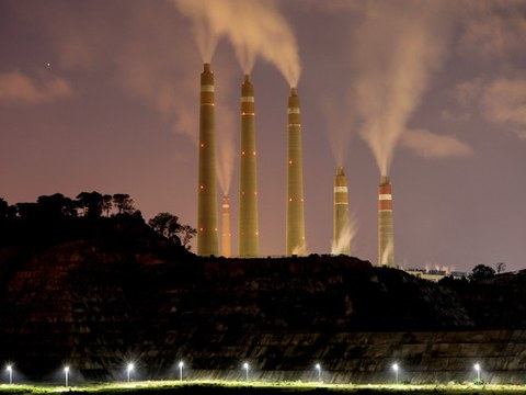 Smoke and steam billow from the coal-fired Banten power plant in Suralaya, Indonesia, July 11, 2020