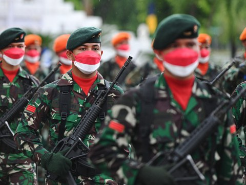 Indonesian soldiers participate in a ceremony in Banda Aceh to mark the nation's 76th Independence Day, Aug. 17, 2021.