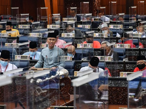 Malaysian Finance Minister Tengku Zafrul Aziz addresses Parliament as he introduces the proposed 2021 budget in Kuala Lumpur, Nov. 6, 2020.