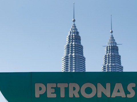 A Petronas gas station sign appears in the foreground of Malaysia's landmark Petronas Twin Towers in Kuala Lumpur, March 2, 2016.