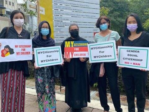 Plaintiffs in a case challenging a law preventing Malaysian women from passing their citizenship on to their children born overseas pose outside the Kuala Lumpur High Court, April 27, 2021.