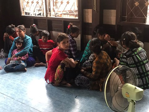 Rohingya who illegally entered Thailand and were bound for Malaysia, sit in a house in Bangkok, Jan. 3, 2021.