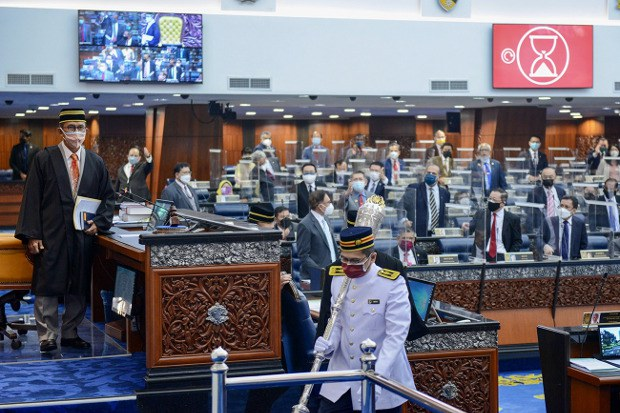 Lawmakers from the lower house of parliament are seen standing in protest against the administration after the palace rebuked the government for misleading the legislature, in Kuala Lumpur, July 29, 2012.