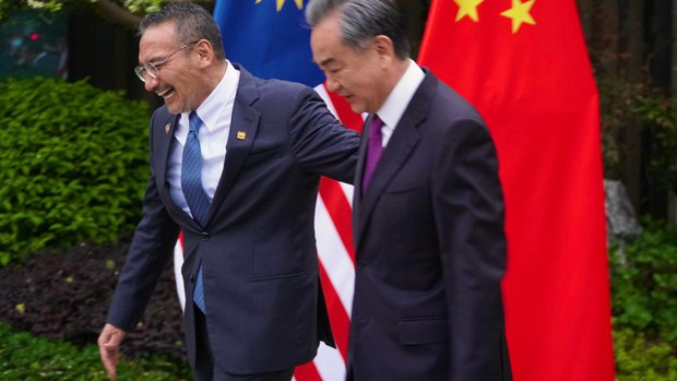 Hishammuddin Hussein (left), Malaysia's then foreign minister, walks with Chinese counterpart Wang Yi in Fujian, China, April 1, 2021.