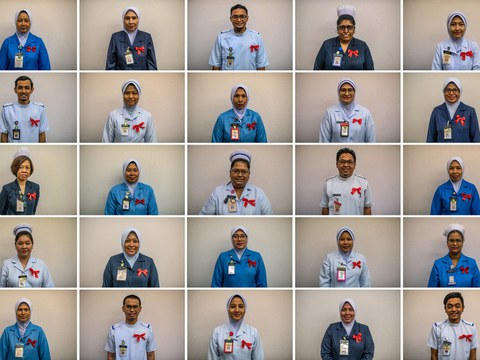 Frontline COVID-19 workers at Selayang Hospital in Malaysia pose for pictures during International Nurses Day, May 12, 2020.