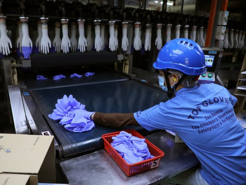 An employee works at a production line in Top Glove's factory in Shah Alam, Malaysia, Aug. 26, 2020.