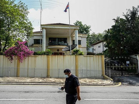 A policeman walks in front of the North Korean Embassy in Kuala Lumpur, March 19, 2021.