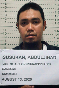 Abduljihad Susukan, a suspected commander of the Abu Sayyaf militant group, poses for a photo at the Davao City police station in the southern Philippines after he was taken into custody, Aug. 13, 2020. [Handout photo from Philippine National Police via AP]