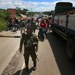 Troops secure the highway outside Datu Paglas town in Maguindanao, Philippines, during an attack by members of the Bangsamoro Islamic Freedom Fighters, a group aligned with the Islamic State, May 8, 2021.