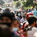 People wear masks and face shields as they queue to board public buses and jeepneys during a community quarantine in Manila, Feb. 2, 2021.