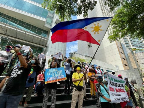 Filipino fishermen and activists rally in front of the Chinese consulate in Metro Manila as the country marked the fifth anniversary of an arbitral award that dismissed Beijing's expansive claims in the South China Sea, July 12, 2021.