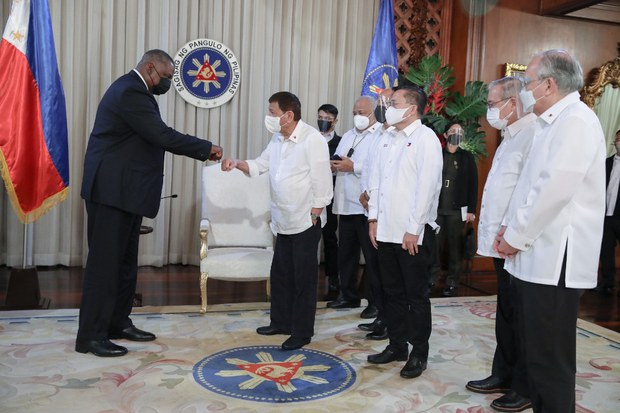 U.S. Secretary of Defense Lloyd Austin (left) bumps fists with Philippine President Rodrigo Duterte during his visit to the Malacañang Palace in Manila, July 29, 2021.