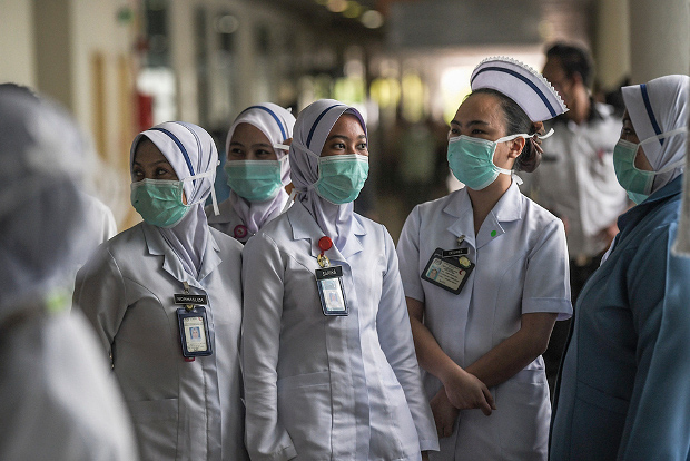 Health officials and nurses wear masks at the Sungai Buloh Hospital in Selangor, Malaysia, March 12, 2020. [S. Mahfuz/BenarNews]