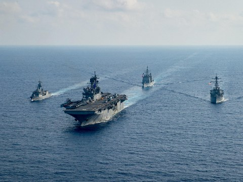 The HMAS Parramatta (left), a Royal Australian Navy guided-missile frigate, sails with the U.S. Navy amphibious assault ship USS America and other American warships in the South China Sea, April 18, 2020.