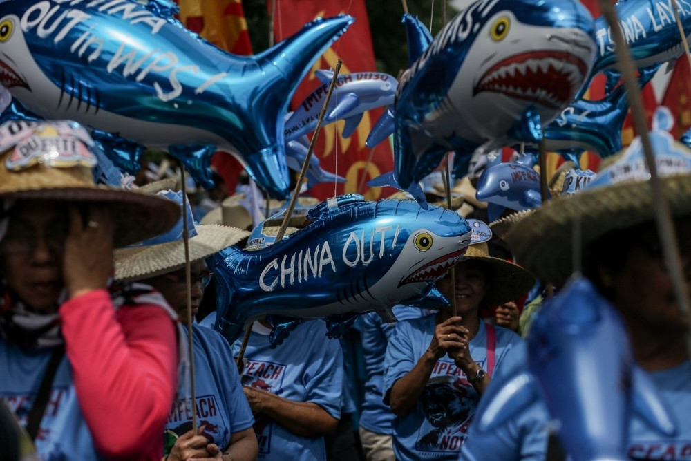 Protesters in Manila call on China to leave the West Philippines Sea (WPS), the Philippines' name for the South China Sea, in this file photo dated July 22, 2019.