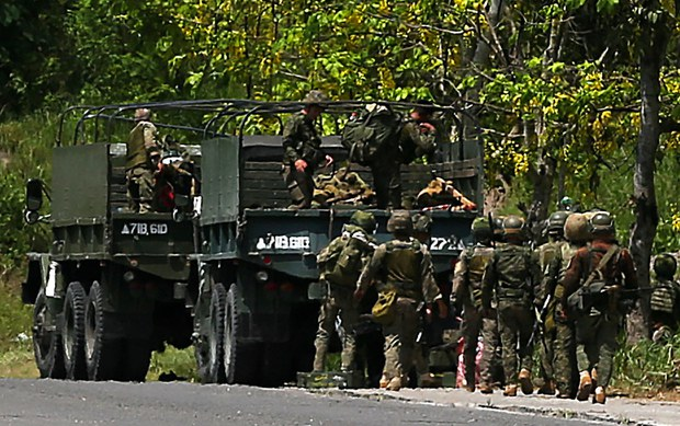 Troops prepare to secure a roadway near the town of Datu Paglas in Maguindanao during an attack by Bangsamoro Islamic Freedom Fighters members, May 8, 2021.