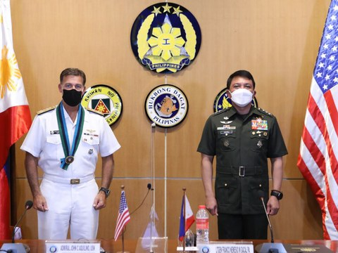 U.S. Indo-Pacific Command chief Adm. John Aquilino (left) stands alongside Armed Forces of the Philippines Inspector General Lt. Gen. Franco Nemesio Gacal during a meeting in Manila, Aug. 23, 2021.  [Armed Forces of the Philippines Handout]