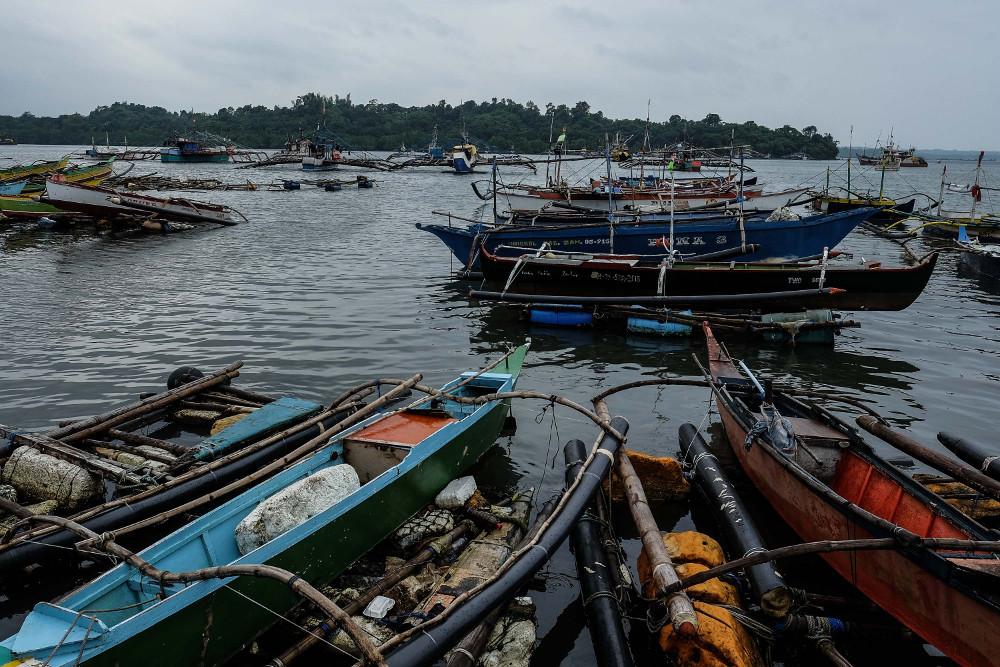 Fishing boats are anchored in Matalvis, a village in Masinloc, Zambales province, Philippines. Sept. 6, 2019. [Jojo Rinoza/BenarNews]