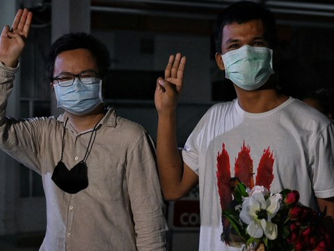 "Thai pro-democracy activists Arnon Nampa (left) and Panupong ""Mike"" Jadnok flash a three-finger salute after leaving Thammasat University Hospital in Bangkok, June 1, 2021."