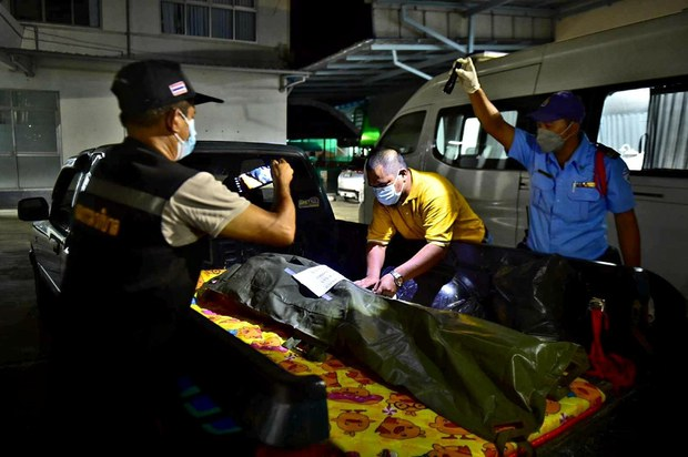 Officials secure the bagged body of Sufian Yusof, a slain insurgent suspect, ahead of an autopsy at Yi-Ngo Hospital in Narathiwat province in southern Thailand, Oct. 13, 2021.