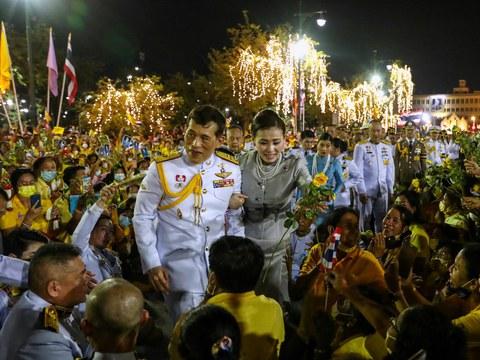 Thai King Maha Vajiralongkorn and Queen Suthida greet supporters outside the Grand Palace in Bangkok, Nov. 1, 2020.