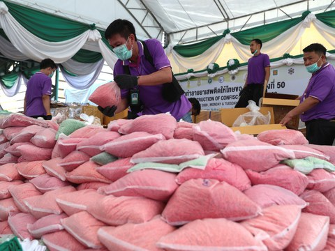 Thai narcotics officials arrange bags of seized methamphetamine pills during the 50th Destruction of Confiscated Narcotics ceremony in Ayutthaya province, Thailand, June 26, 2020.